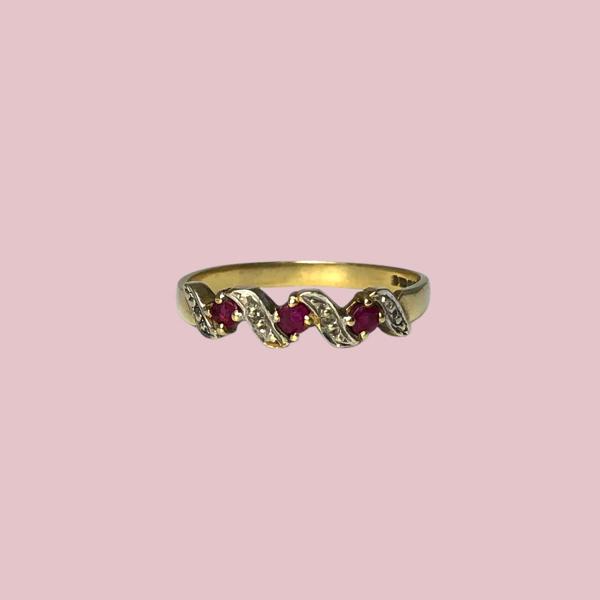 eternity ring met robijn en diamant